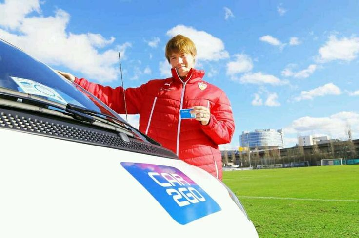 Japanese national football player Gotoku Sakai trying out car2go in Stuttgart.