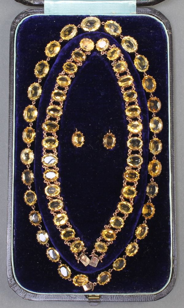 Lot 680, A Victorian gold and citrine set suite of jewellery comprising necklace, 2 bracelets and a pair of earrings, contained in original fitted case EST £300-500