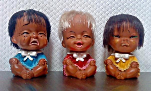 Poppertjes met verschillende gezichtsuitdrukkingen.