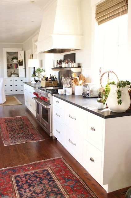for the love of a house - people lust for this kitchen... I love it, too, but I lust for those oriental carpets
