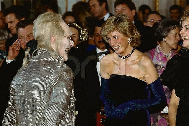 Princess Diana jokes with an actor in full costume on a visit to Germany. November 1987 Germany
