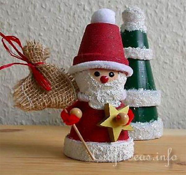 Babbo Natale con vasetti di terracotta