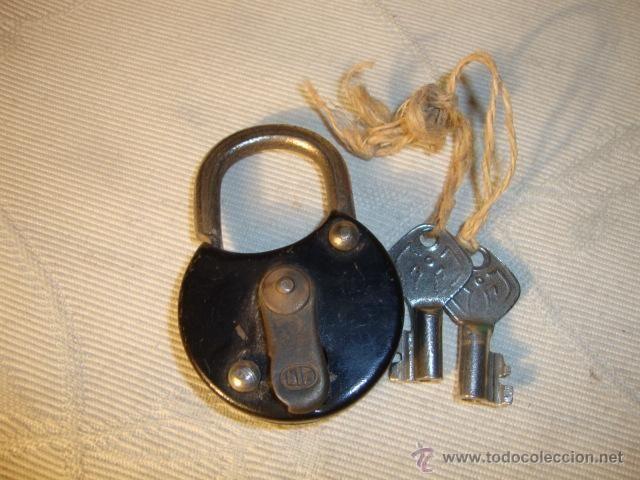 Antiguo candado de hierro colado con sus 2 llaves for Hierro colado