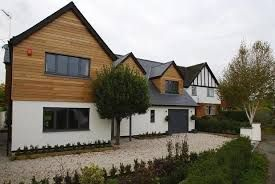 Image result for bungalow render and wooden cladding uk