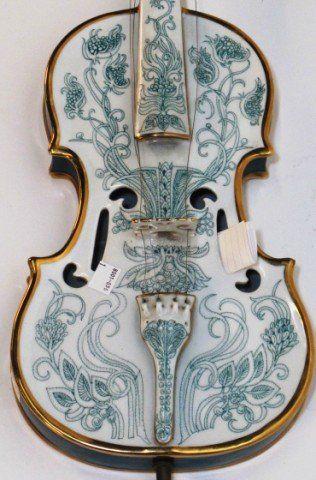 SZASZ ENDRE FULL SIZE PORCELAIN VIOLIN: 20th century. Modern Hungarian green and white glazed porcelain full size violin with parcel gilt decoration.
