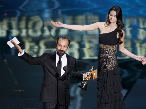 """Asghar Farhadi, director of Iranian film """"A Separation"""" is guided off stage after accepting the Oscar for Best Foreign Language Film at the 84th Academy Awards in Hollywood, California, February 26, 2012."""