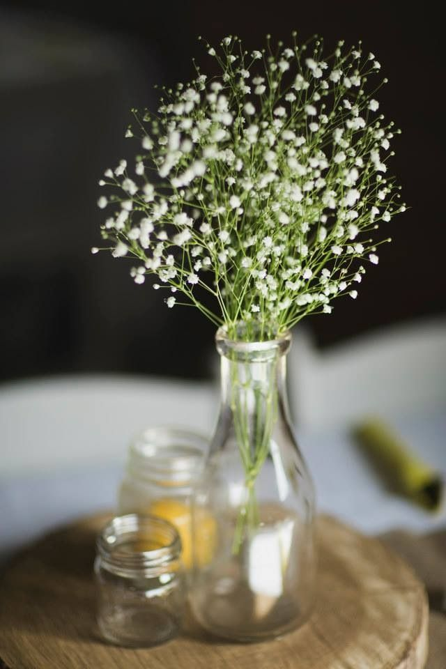 Gypsophila milk bottle centerpieces flower decor for Baby bottles for decoration