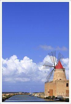 Old windmill near sea, in Mozia-Marsala, Sicily
