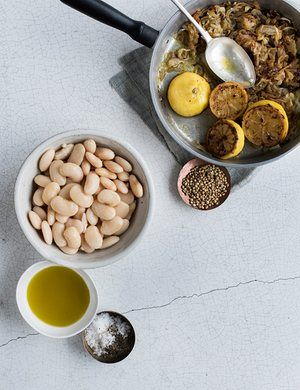 Pan-roasted lemons add a piquant punch to balance out the mellow buttery pulses and slow‑cooked onions in this hummus-style entree.