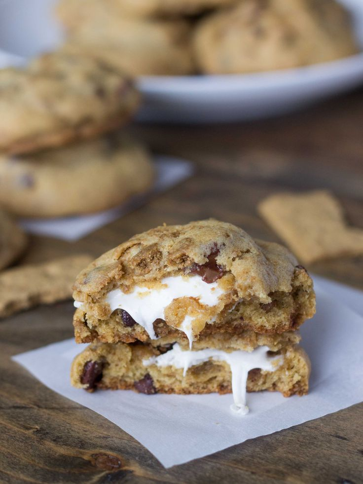 Marshmallow-Stuffed S'mores Cookies. A favorite summer treat in cookie form: Hand-crushed graham crackers, 2 kinds of chocolate chips, and a melty marshmallow within a dark brown sugar and honey dough!