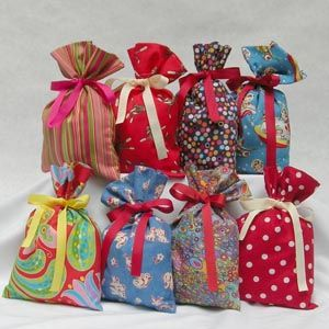 If you own a sewing machine and can only sew a straight stitch, these gift bags are easy to make. Try whipping up a fabric gift bag for those hard to wrap items and see how easy they are to make.