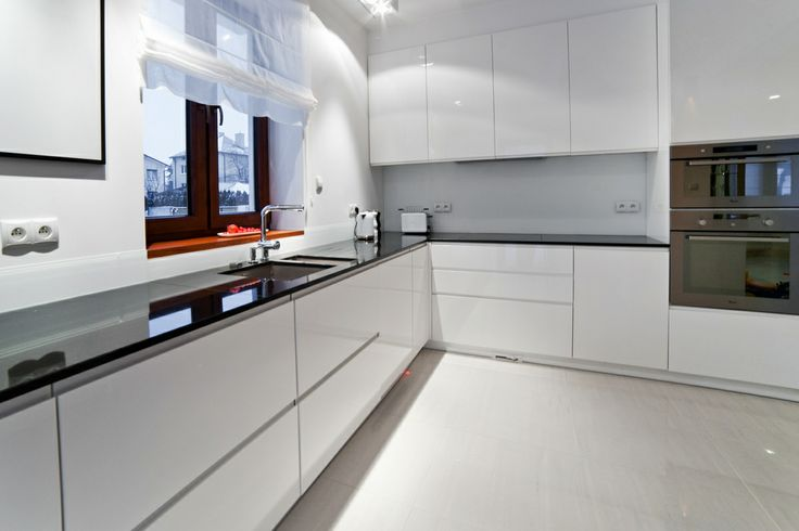 Modern/white kitchen cabinets.
