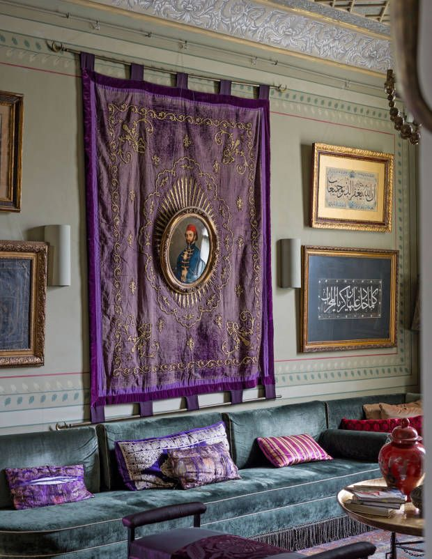 Jewel-toned upholstry and silk wall hangings complement Gulgun's collection of Arabic art and calligraphy.