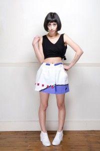 Vintage white Nike graphic print tennis skirt - Skirts - Womens Vintage | Retro & Vintage Clothes UK