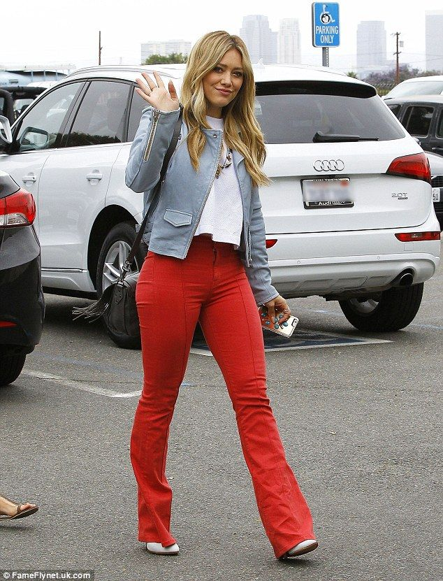 Red hot! Hilary Duff highlighted her shapely figure in a bright red high-waisted flared trousers as she hit the studio in Los Angeles