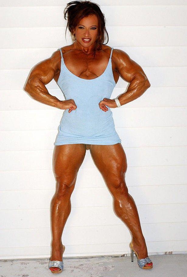Colette Guimond......HUGE pecs when flexing.   Females ...
