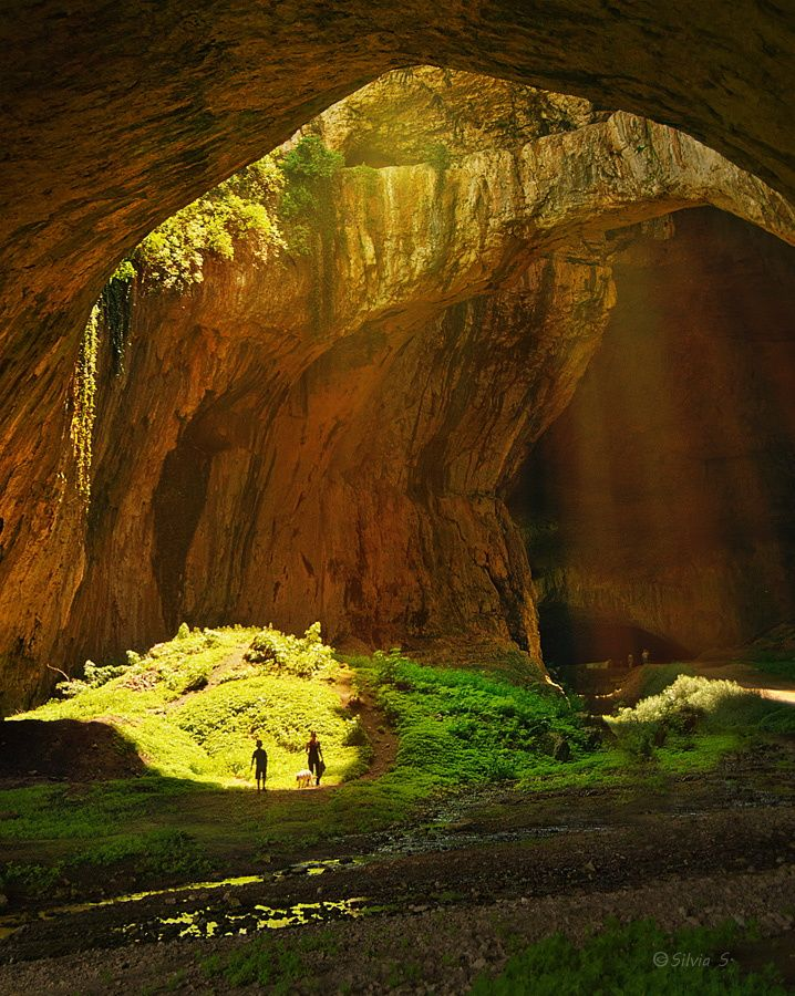 """A cave  - by Silvia S. (""""Devetashka cave-Bulgaria In the early1950s, serious explorations of the cave were held. The studies showed that the cave was inhabited (with some interruptions) during almost every historical era. The earliest traces of human presence date back to the middle of the Early Stone Age before about 70,000 years BC. The Devetashka cave is among the cave deposits with the richest cultural artifacts from the Neolithic Period (6th millennium - 4th millennium BC)."""