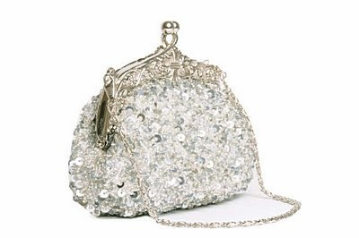 sequinned evening bag, covered in sequins and beads on all sides It's finished with an ornate clasp, silver coloured