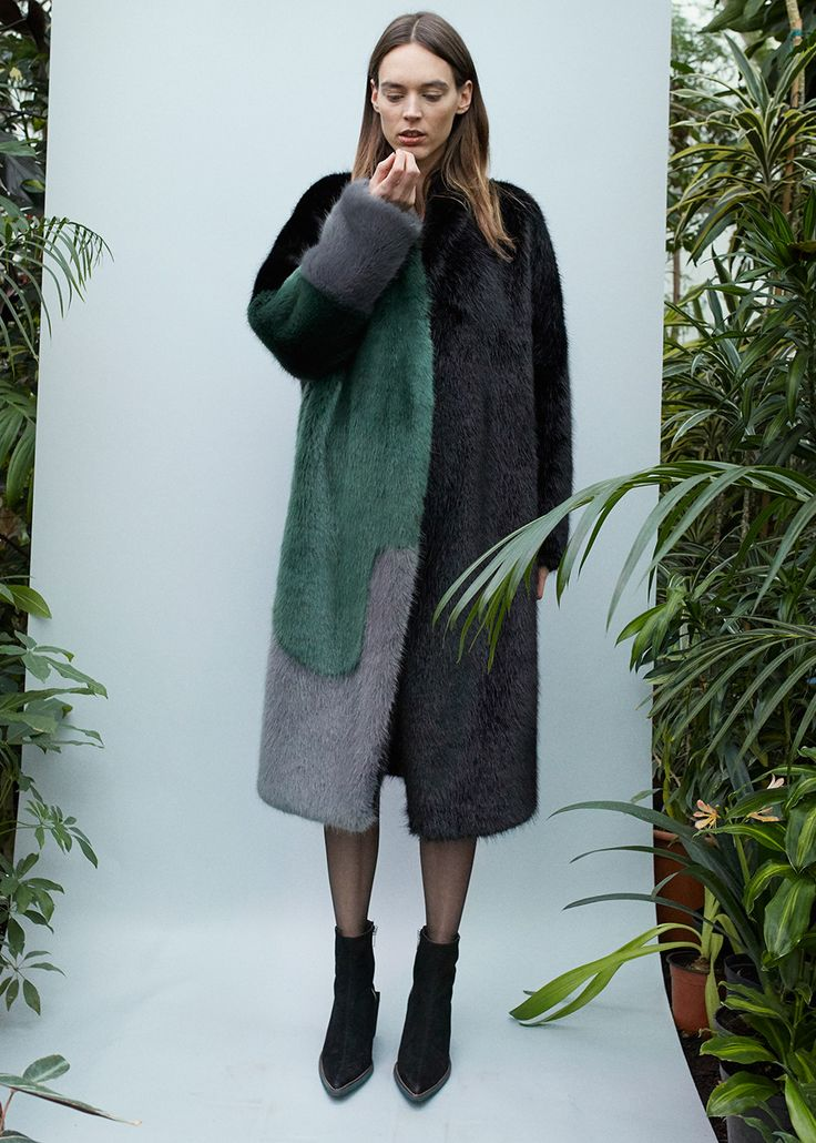 """Black/Green/Grey Soft Faux Fur, Hook Closure, 2 Front Pockets 85% PC, 15% PL 42"""" Length Dry Clean By D.Efect. Made in Lithuania"""