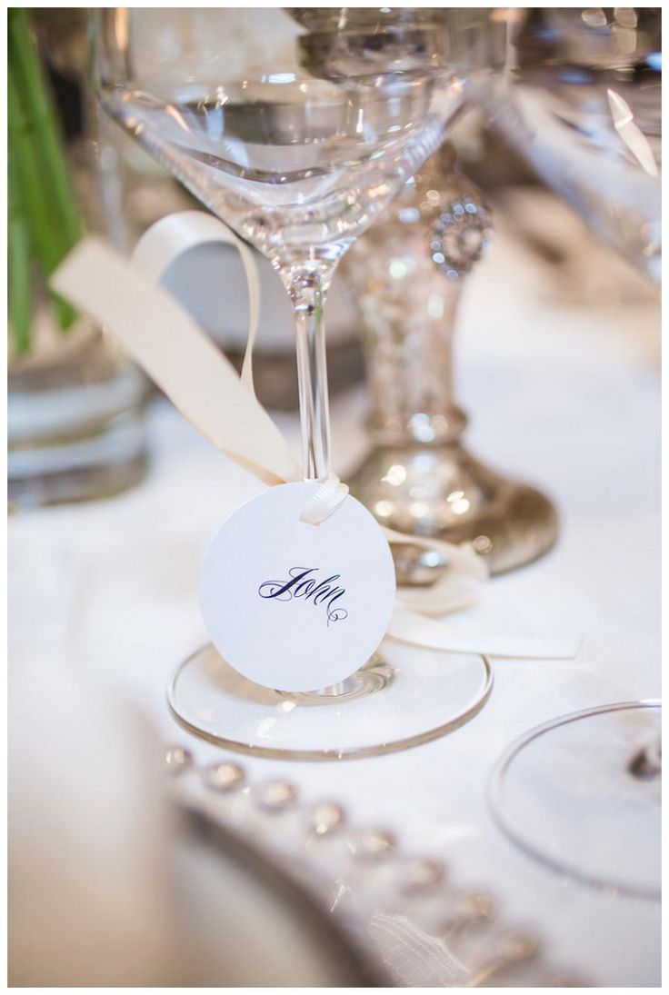 Calligraphy name tags tied to wine glasses by Papered Wonders, Inc, image by Janet Howard Studio.