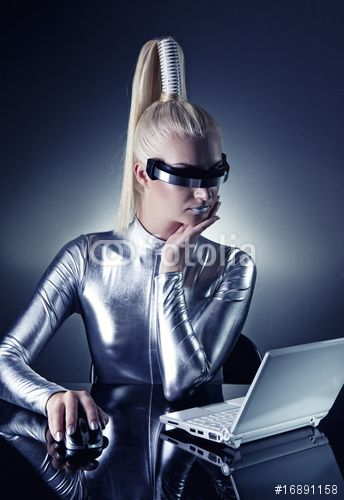 Beautiful cyber woman working on her laptop ....