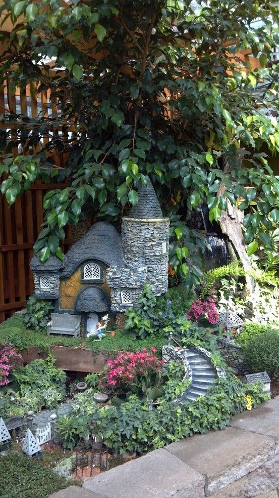 LOVE LOVE LOVE this Faeirie home. Inspirational for Ryan's Magical Forest of Flowers castle.