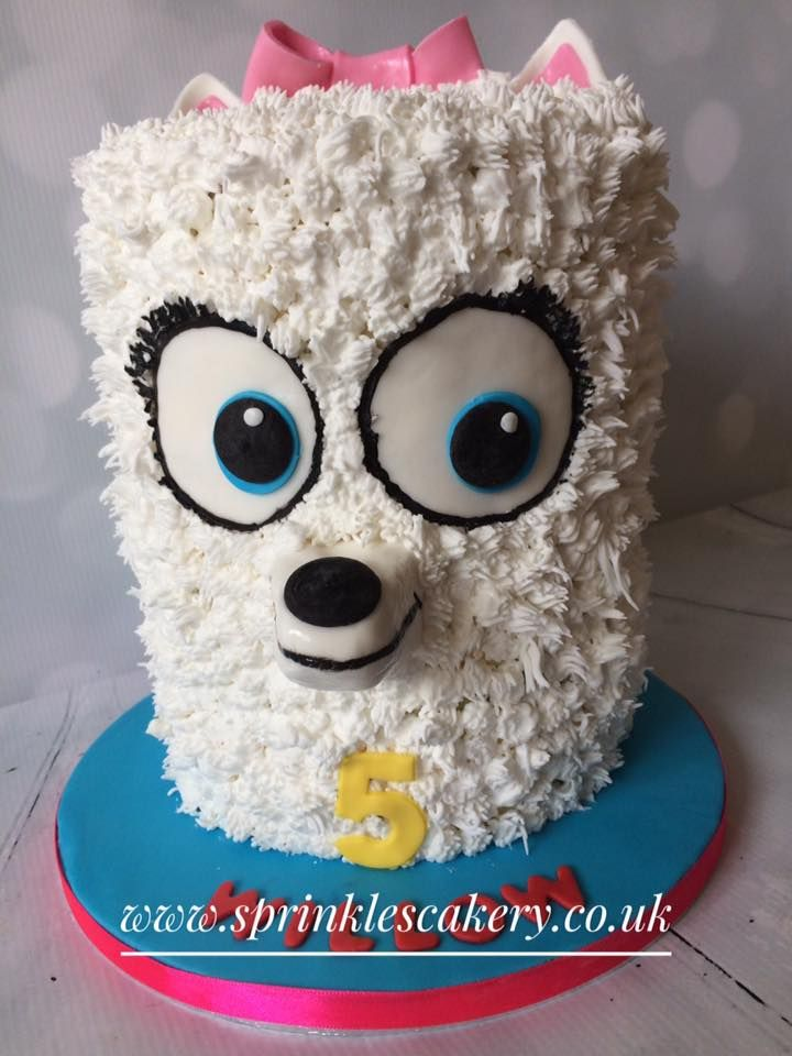 """This """"Secret Life of Pets - Gidget"""" cake is hiding a rainbow layer surprise inside. The fur was piped from royal icing to give it its bright white colour with other details added in fondant and edible paints."""