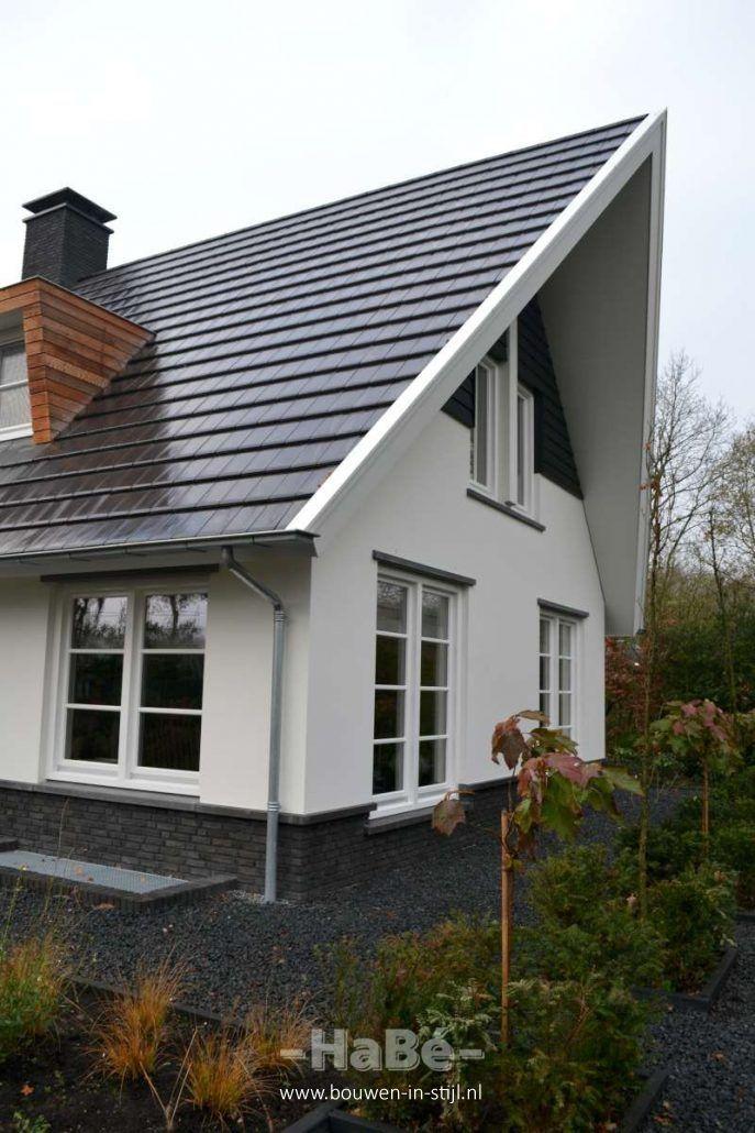 Woonhuis met veranda en bijgebouw