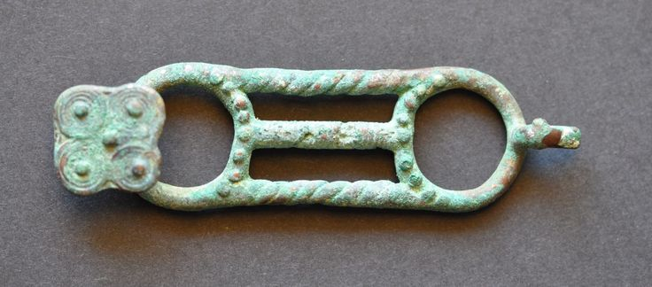 Amlash Bactrian bronze belt buckle 10, 1st millenium B.C. Amlash Bactrian bronze belt buckle with bird head and spirals as tail, 10.4 cm long, 44.3 gr weight. Private collection
