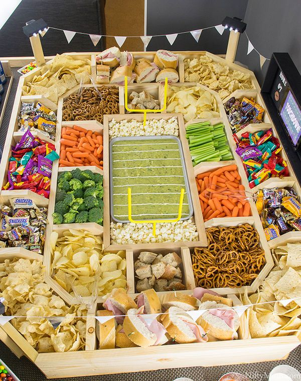Stadium Snacks: Are you a mother of the groom looking for a clever and casual idea for a rehearsal dinner? Wow your new daughter with this wooden stadium snack station. This would also be adorable at a bridal shower or cocktail hour. Personalize with whatever local fare is served at your stadium.