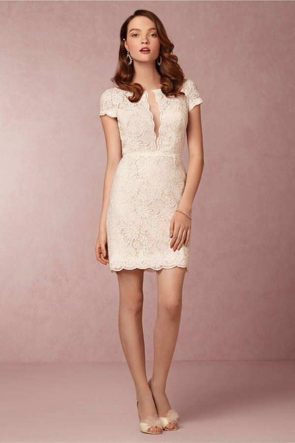Without that super deep open collar illusion neckline, this lace shift would be right at home at any vintage wedding. | See more modern bridesmaid dresses here: http://www.mywedding.com/articles/modern-bridesmaid-dresses/