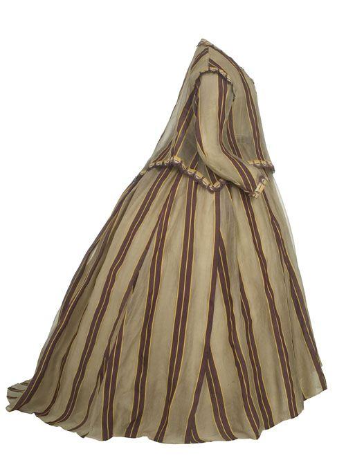 Vestido   Romanticismo, ca. 1860-1868  Vestido formado por blusa y falda en glasé listada en tres colores: morado, amarillo y gris. La blusa va decorada con una aplicación de pasamanería, con estrecho pie calado a modo de encaje, bordado mecánico a base de diminutas florecillas y remate en flecos. La falda, fruncida en la cintura, con pliegues muy menudos en la espalda y suave cola.  MT001007-08