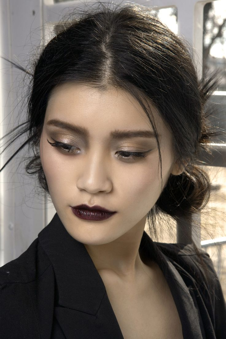 """Fascinating mix of color palettes; love how the deep lipstick isn't overwhelming somehow, and the eye makeup is fantastic. """"Ming Xi, backstage at Christian Dior Fall 2010 Ready to Wear"""""""