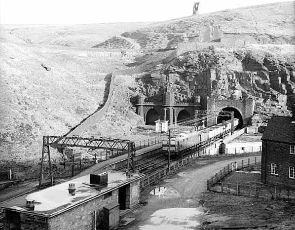 The original Woodhead tunnel and newer tunnel with the staion in 1964.