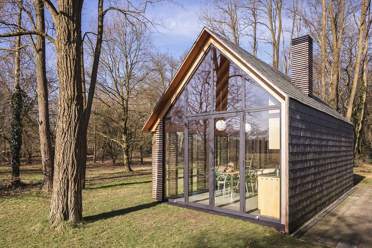 Handmade Cabin Glass Wall, The Netherlands - slate shingles and flowers planted to create views. What if I had a smaller view off my mountain, and then planted things and sculpted the land to make it more interesting?
