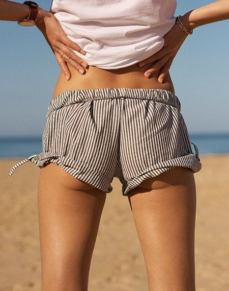 madewell pull-on side-tie shorts worn with the horse™ original watch + seed bead charm bracelets.