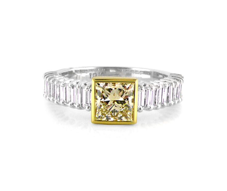 A Modern and Chic 18ct White and Yellow Gold Diamond Ring with a Fancy Yellow Princess Cut Diamond in the Center