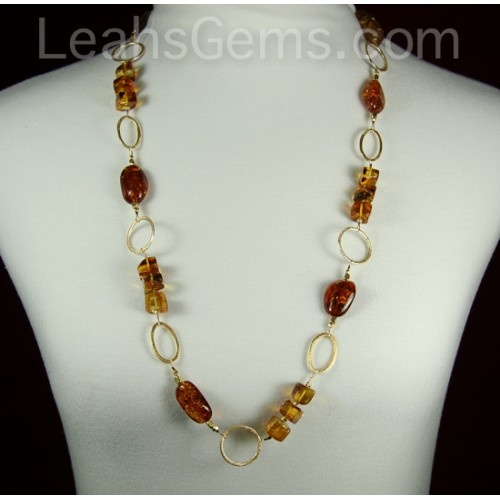This is an amazing amber necklace with 14 karat gold plated copper chain to really make a statement. The amber pieces are very high quality and have great depth.