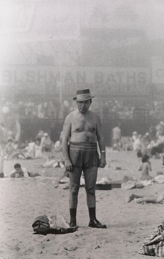 Diane Arbis (US 1923-1971) Man in hat, trunks, socks and shoes, Coney Island, NY, 1960
