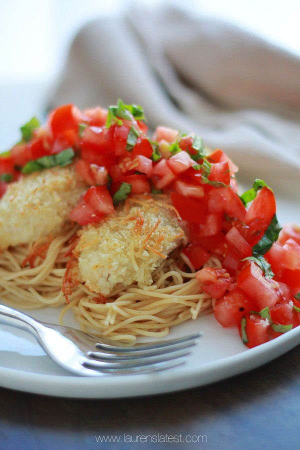 Bruschetta Chicken...Breaded and baked chicken tenders served over buttered angel hair pasta and topped with fresh tomato bruschetta!!