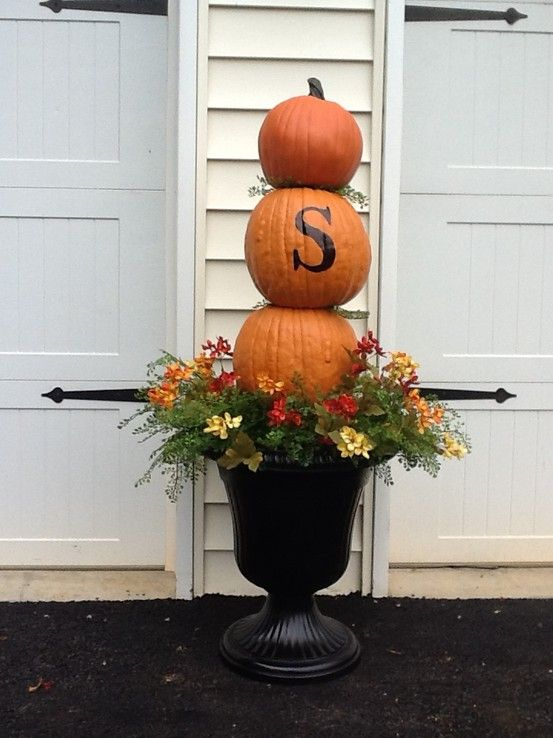 Fall topiary Pumpkin urn for Halloween through Thanksgiving using foam carvable pumpkins from craft store