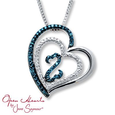 The iconic Open Hearts symbol is adorned in blue diamonds and nested inside two hearts in this delightful necklace for her from the Open Hearts by Jane Seymour® collection. Round blue and white diamonds on the larger hearts complete the look. The sterling silver pendant sways from an 18-inch box chain secured with a lobster clasp and has a total diamond weight of 1/15 carat. Blue diamonds are treated to permanently create the intense blue color. Diamond Total Carat Weight may range from ...
