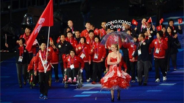 Wa Wai So of Hong Kong, China carries the flag