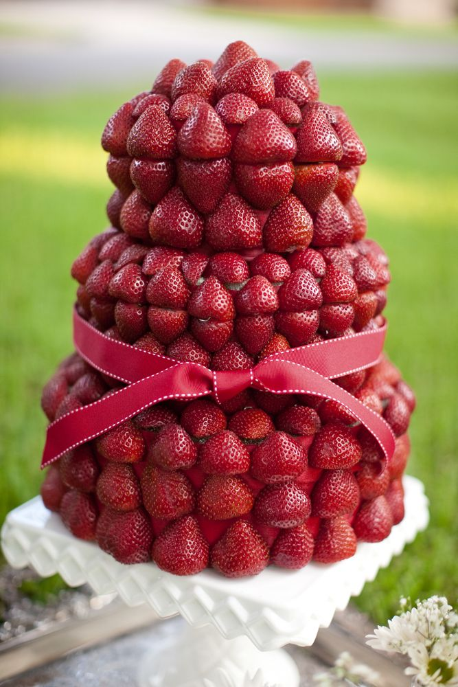 A fun twist on the wedding cake tradition - a strawberry cake! Would you have this alternative option at your wedding?
