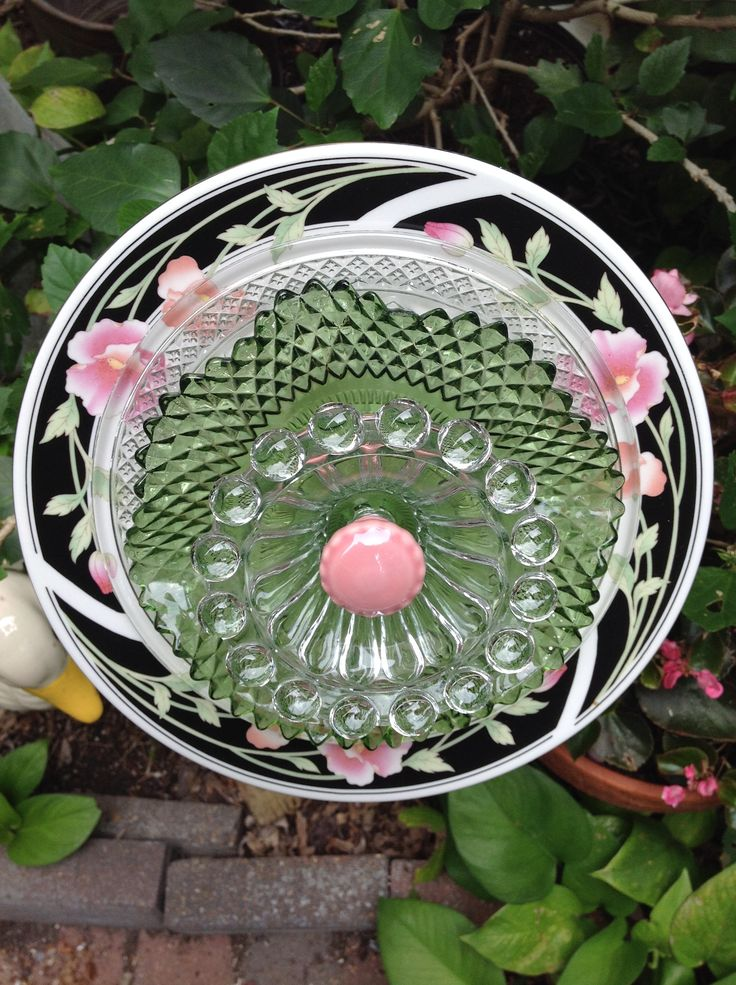 Another black, pink and green flower with vintage green crystal bowl and vintage candleholder as center. SOLD at Galveston Island Market MiMi's Plate Flowers