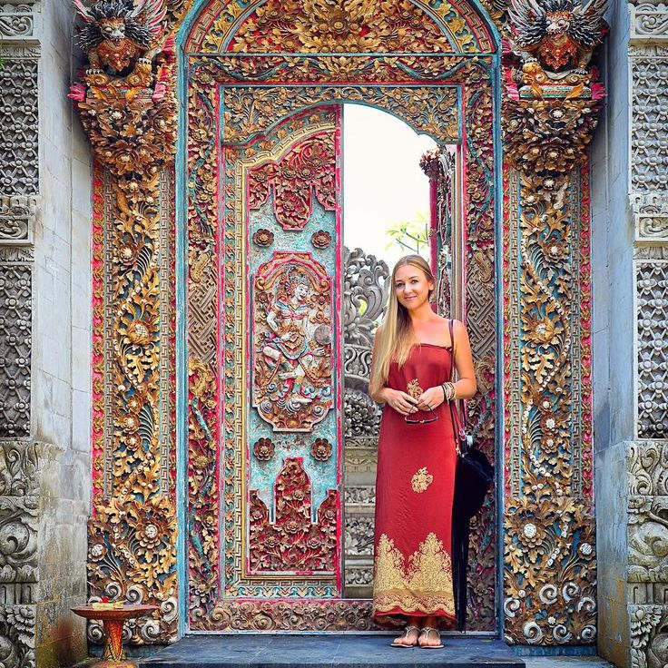 Crazy amount of detail and patterns on this doorway in Bali (Indonesia). Luiza is wearing a silk sarong bought on the Ubud market. Photo by TravelPlusStyle.com ••