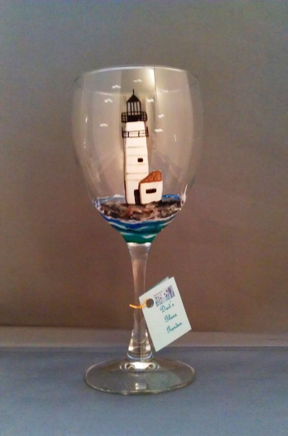 White Wine Glass 10oz Lighthouse. Your choice of lighthouse, seagulls flying around and sitting with the ocean around it. Baked for durability