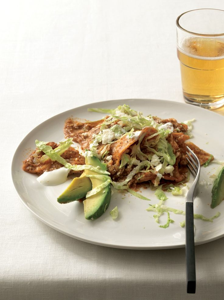 Chilaquiles (omit the eggs, sour cream, cheese for vegan; serve with refried beans...yumm)