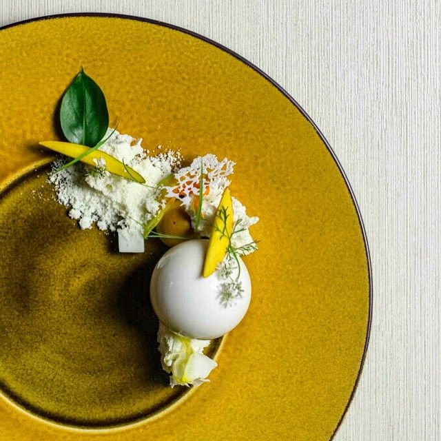 """Amazing Dessert by chef frederic monti - Yogurt white chocolate Mousse, coconut snow, basil Yuzu cake on Antonio Bachour's IG #plating #gastronomy"