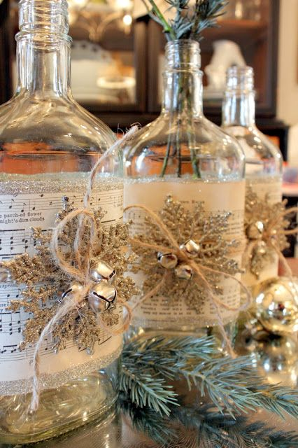 Altered Bottles - Create a vintage centerpiece with glass bottles, sheet music, glitter, Mod Podge, twine, ornaments, and bells. Easy way to recycle and upcycle.